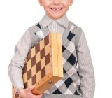 little-boy-with-chessboard