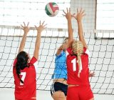 girls-playing-volleyball-indoor-game